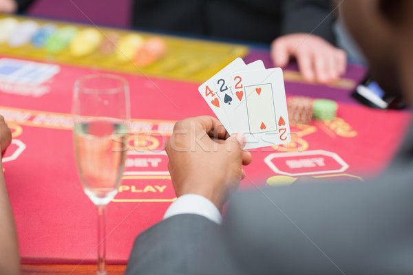 Man holding up poker hand in casino Stock photo © wavebreak_media