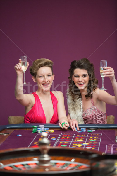 Donne champagne occhiali roulette tavola casino Foto d'archivio © wavebreak_media