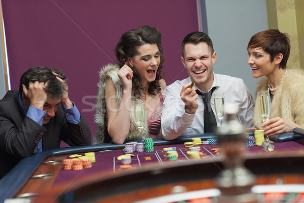Ganador perdedor ruleta mesa casino dinero Foto stock © wavebreak_media