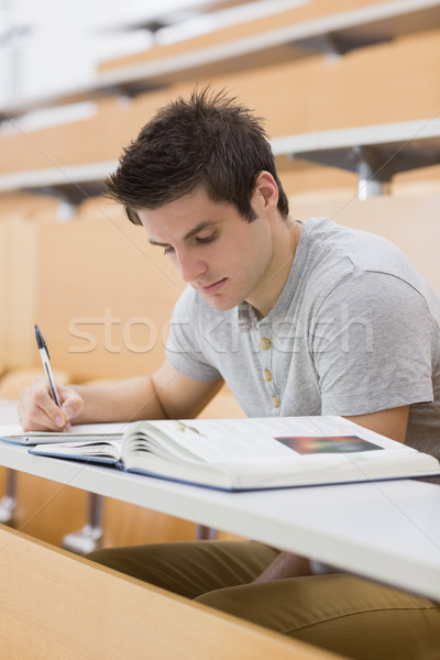 Man sitting at the lecture hall while writing  Stock photo © wavebreak_media