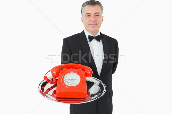 Waiter holding red phone on silver tray Stock photo © wavebreak_media