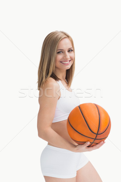 Portré boldog nő sportruha tart kosárlabda Stock fotó © wavebreak_media