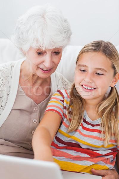 Little girl and granny using laptop Stock photo © wavebreak_media