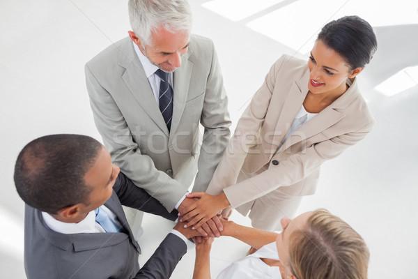 Csapat áll együtt felfelé kezek munkahely Stock fotó © wavebreak_media
