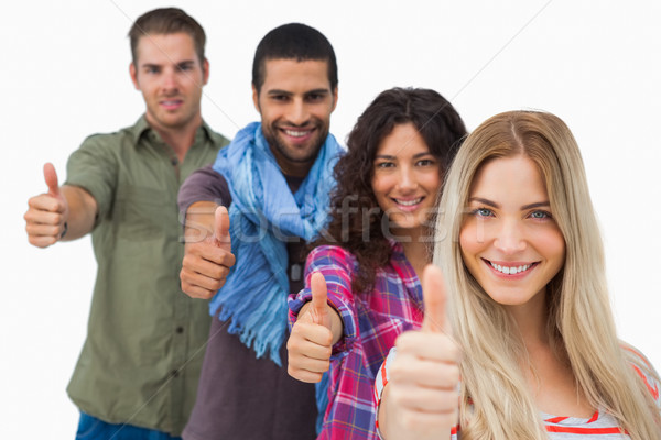 Friends giving thumbs up in a row Stock photo © wavebreak_media