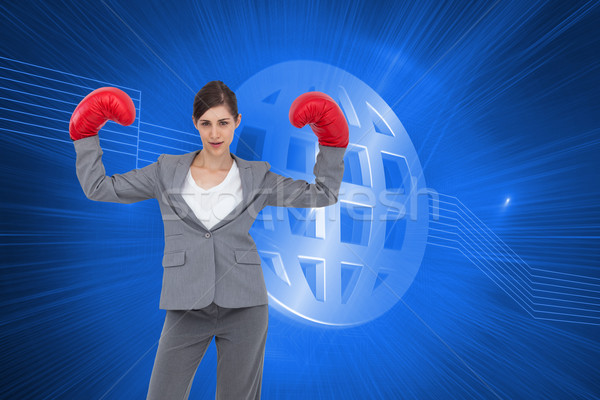 Composite image of businesswoman with boxing gloves Stock photo © wavebreak_media