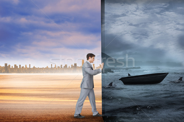 Composite image of businessman pushing away scene Stock photo © wavebreak_media
