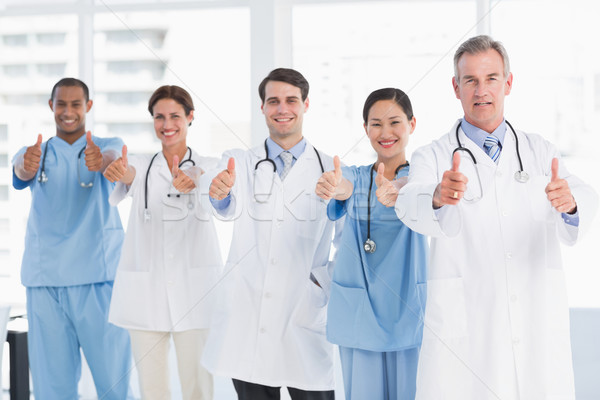 Confident doctors gesturing thumbs up at hospital Stock photo © wavebreak_media