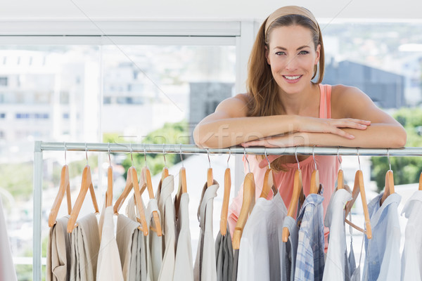 Female fashion designer with rack of clothes in store Stock photo © wavebreak_media