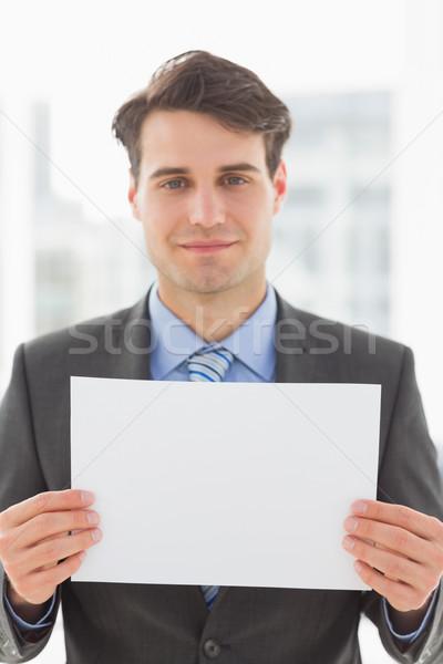 улыбаясь бизнесмен пустая страница служба костюм Сток-фото © wavebreak_media