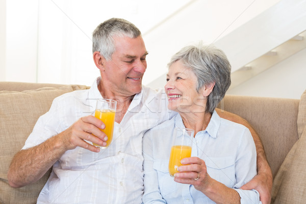 Senior couple sitting on couch drinking orange juice Stock photo © wavebreak_media