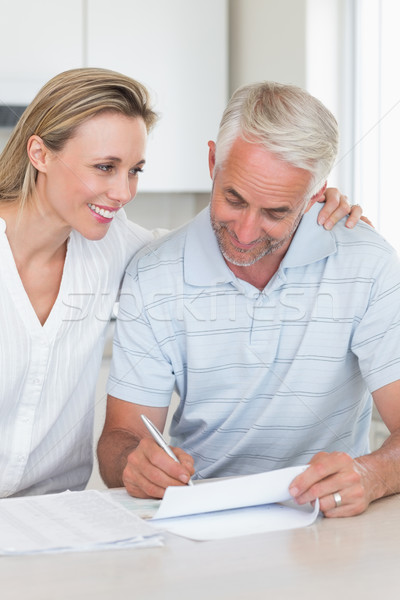 Happy couple working out their finances Stock photo © wavebreak_media