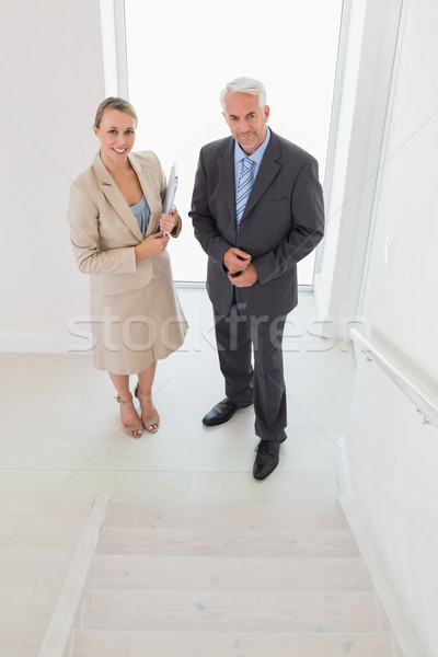 Smiling estate agent standing with potential buyer Stock photo © wavebreak_media
