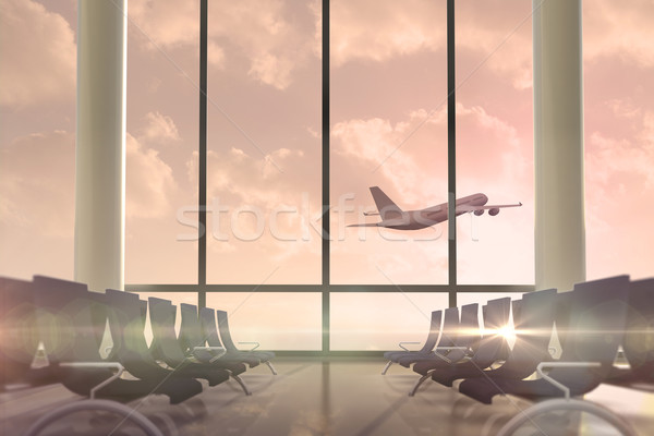 Airplane flying past departures lounge window  Stock photo © wavebreak_media