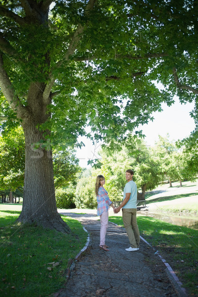 Cute affectionate couple walking hand in hand in the park  Stock photo © wavebreak_media