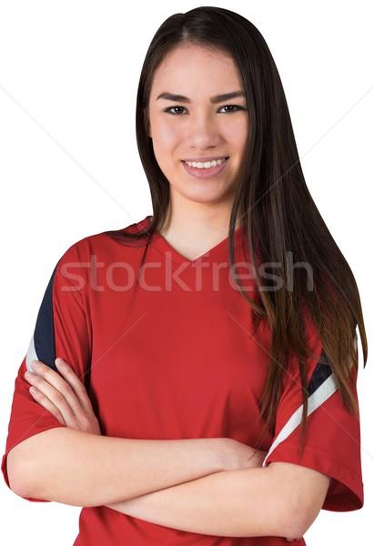 Uśmiechnięty asian piłka nożna fan patrząc kamery Zdjęcia stock © wavebreak_media