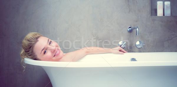 Serein bain souriant caméra maison Photo stock © wavebreak_media