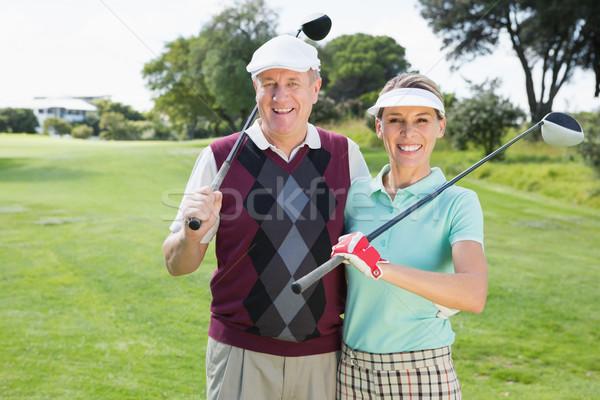 Golfing couple smiling at camera Stock photo © wavebreak_media