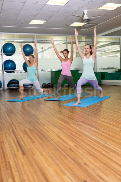 Yoga class in warrior pose in fitness studio Stock photo © wavebreak_media