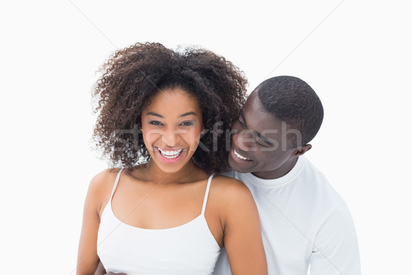 Attractive couple in matching clothes smiling at camera Stock photo © wavebreak_media