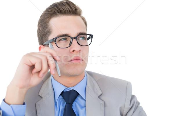 Nerdy businessman holding pen looking away Stock photo © wavebreak_media