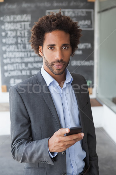 Handsome businessman texting on phone Stock photo © wavebreak_media