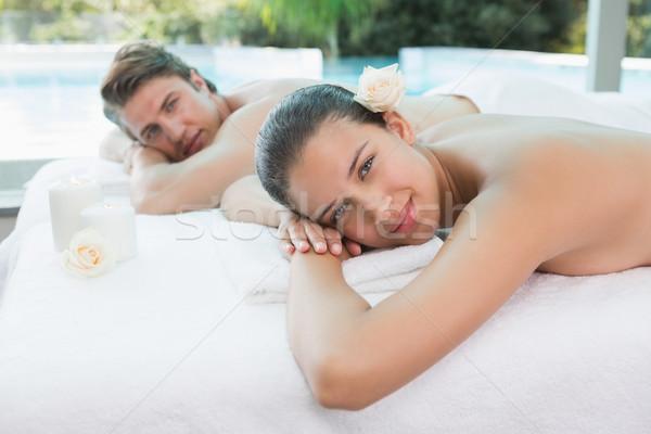 Couple lying on massage table at spa center Stock photo © wavebreak_media