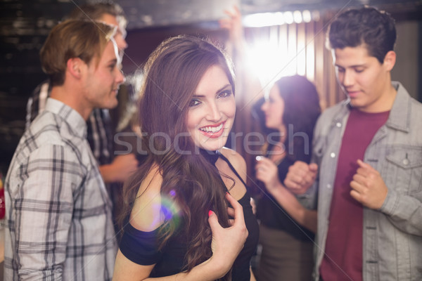 Stylish brunette smiling at camera Stock photo © wavebreak_media