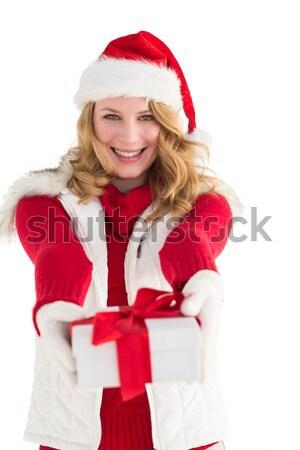 Pretty girl in santa costume looking at camera Stock photo © wavebreak_media