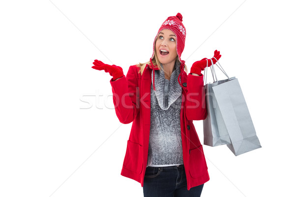 Happy blonde in winter clothes holding shopping bags Stock photo © wavebreak_media