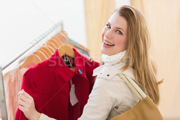 Smiling blonde picking out jacket Stock photo © wavebreak_media