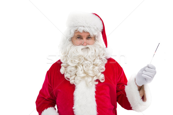 Portrait of perplexed santa holding  Stock photo © wavebreak_media
