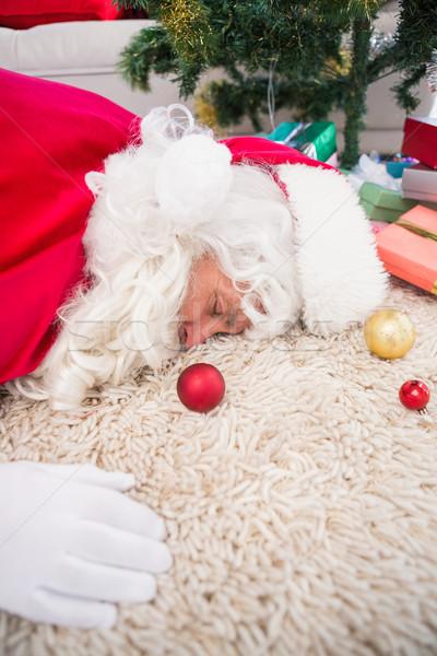 исчерпанный спальный ковер подарки рождественская елка Сток-фото © wavebreak_media