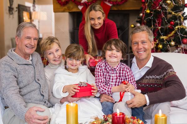 Multi generation family holding presents on sofa Stock photo © wavebreak_media