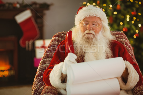Santa claus writing his list with a quill Stock photo © wavebreak_media