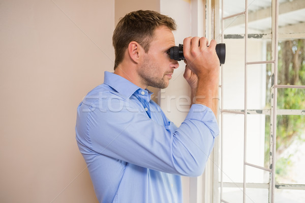 Man looking through a binoculars Stock photo © wavebreak_media