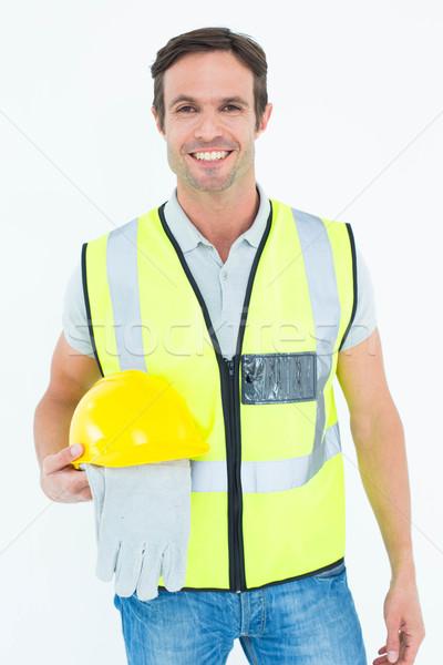 Trabajador de la construcción guantes casco de seguridad retrato blanco Foto stock © wavebreak_media