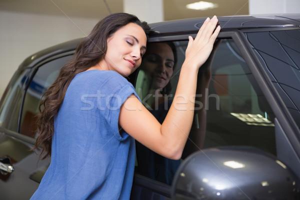 Mosolygó nő ölel fekete autó új autó bemutatóterem Stock fotó © wavebreak_media