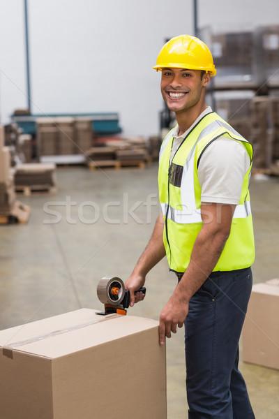 Worker preparing goods for dispatch Stock photo © wavebreak_media