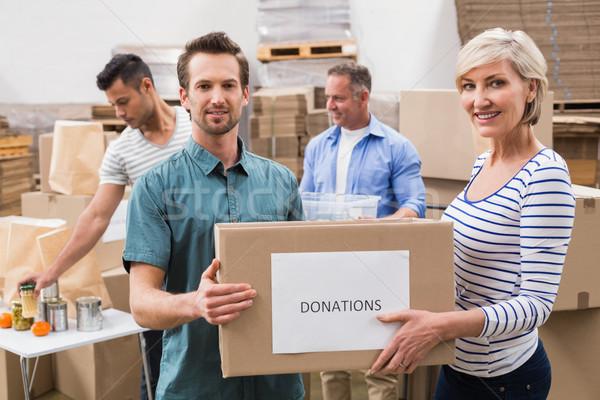 Dois voluntários doações caixa grande Foto stock © wavebreak_media
