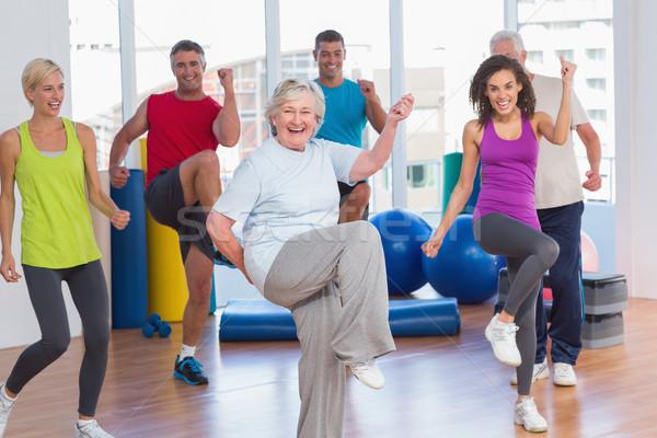 People doing power fitness exercise at fitness studio Stock photo © wavebreak_media