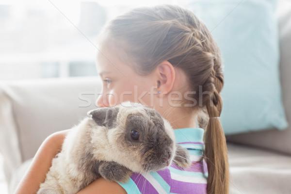 Lány tart nyúl otthon oldalnézet ház Stock fotó © wavebreak_media