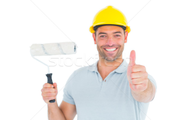 Manual worker with paint roller gesturing thumbs up Stock photo © wavebreak_media