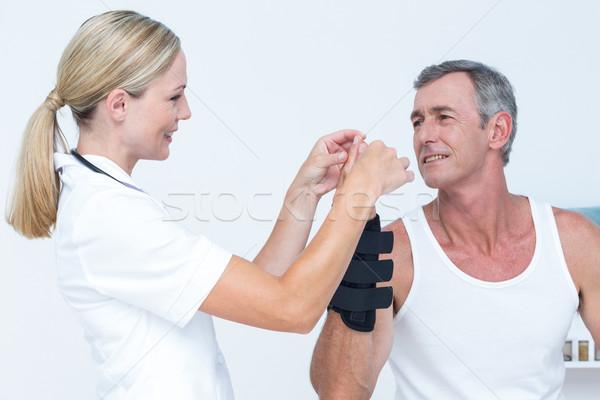 Doctor examining a man wrist Stock photo © wavebreak_media