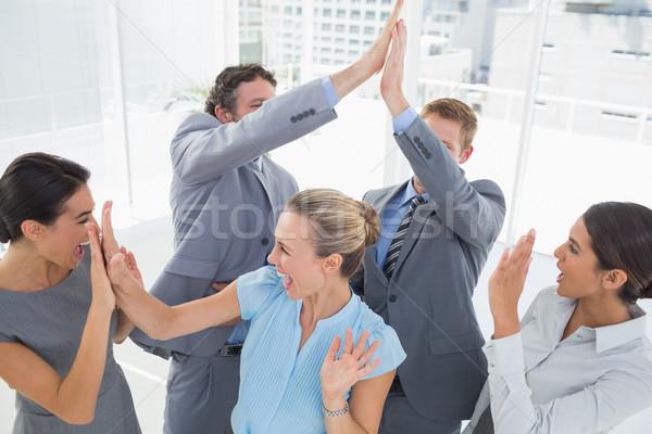 Podniecony zespół firmy biuro kobieta szczęśliwy Zdjęcia stock © wavebreak_media