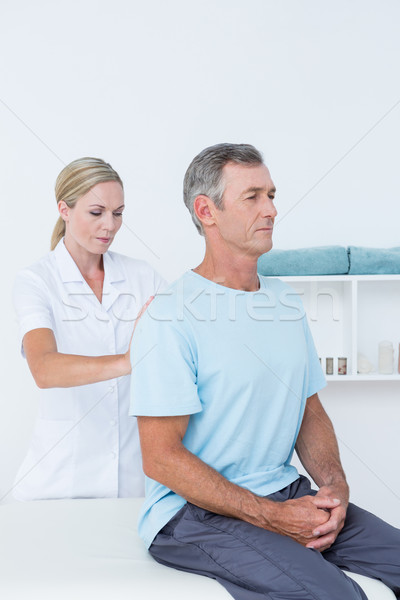 Doctor examining her patient back  Stock photo © wavebreak_media