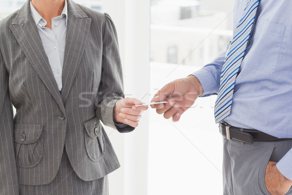 Businessman giving his business card to his colleague Stock photo © wavebreak_media