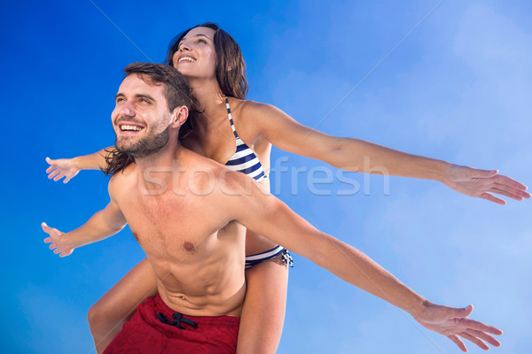 Człowiek powrót sympatia plaży Zdjęcia stock © wavebreak_media