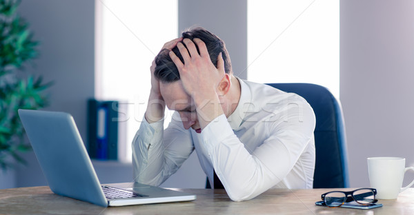 Upset businessman with head in hands Stock photo © wavebreak_media