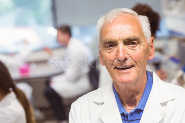 Science lecturer smiling at camera Stock photo © wavebreak_media